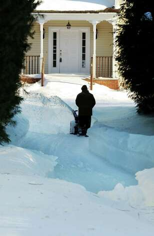 Residents continue to dig their way out on Brookside Dr. in Fairfield, Conn. on Friday, Feb. 9, 2013. Southwestern Connecticut was hit by one of the biggest snowstorms in history, a howling blizzard that dumped over two feet of snow across the area. Photo: Cathy Zuraw / Connecticut Post