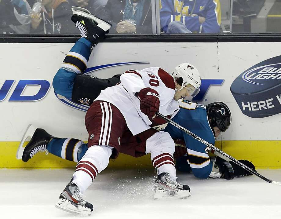 Phoenix Coyotes center Antoine Vermette (50) collides against San Jose Sharks right wing Ryane Clowe against the boards  during overtime of an NHL hockey game in San Jose, Calif., Saturday, Feb. 9, 2013. Phoenix won 1-0 in a shootout. (AP Photo/Marcio Jose Sanchez) Photo: Marcio Jose Sanchez, Associated Press