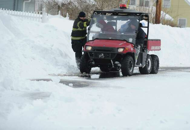 The Derby Storm Rescue truck shuttles an employee to work at Griffin Hospital in Derby, Conn. as residents remain strandedl Saturday, Feb. 9, 2013 following a severe blizzard that dumped up to three feet of snow across the state. Photo: Autumn Driscoll