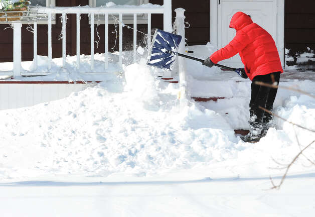 Lou Petrillo digs out in front of his house after a blizzard pounded the region in West Haven, Conn. on Saturday February 9, 2013. Photo: Christian Abraham / Connecticut Post