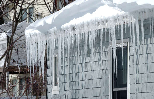 Huge icicles hang down from a house after the blizzard which pounded the region in West Haven, Conn. on Saturday February 9, 2013. Photo: Christian Abraham / Connecticut Post