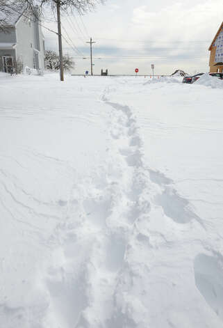 Footsteps are the only marks made on a side street after a blizzard pounded the region in West Haven, Conn. on Saturday February 9, 2013. Photo: Christian Abraham / Connecticut Post