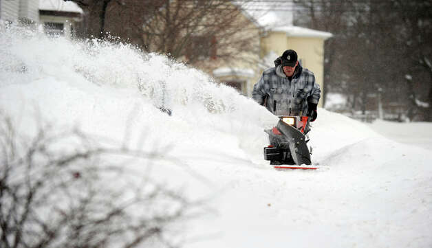 Brandon Hyde, 32, uses a snowblower to clear the sidewalk near his home on Roberts Ave. in Danbury, Conn. Saturday morning, February 9, 2013. A blizzard dumped almost two feet of snow in the Danbury area Friday and Saturday. Photo: Carol Kaliff / The News-Times
