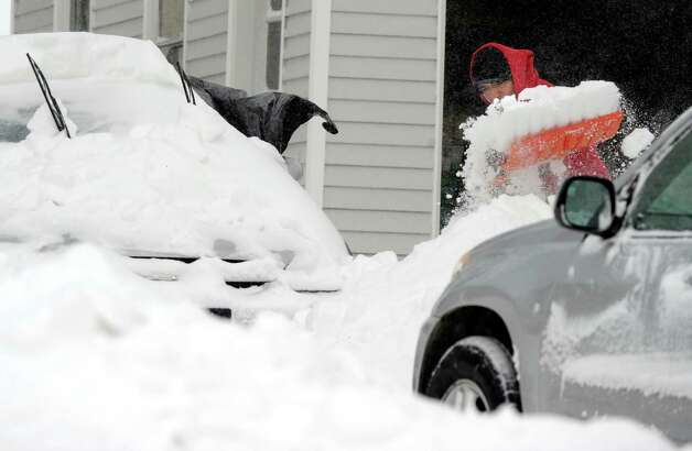 Walter Lojar, of Danbury, Conn. digs his car out Saturday morning, Feb. 9, 2013, from the almost two feet of snow dumped on the area by Friday and Saturday's blizzard. Photo: Carol Kaliff / The News-Times