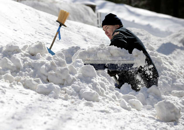 Bob Martin, of Nashville Road in Bethel, digs out after a blizzrd dumped almost two feet of snow in the area Friday and early Saturday morning, Feb. 9, 2013. Photo: Carol Kaliff / The News-Times