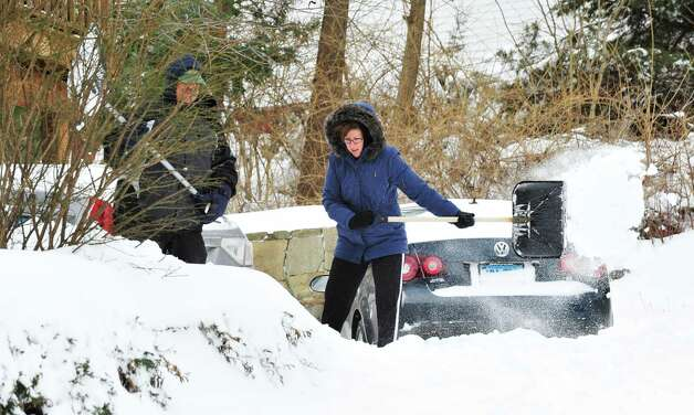 Frank and Mary Oleksvik dig out of the snow in Danbury Saturday, Feb. 9, 2013. Photo: Michael Duffy / The News-Times