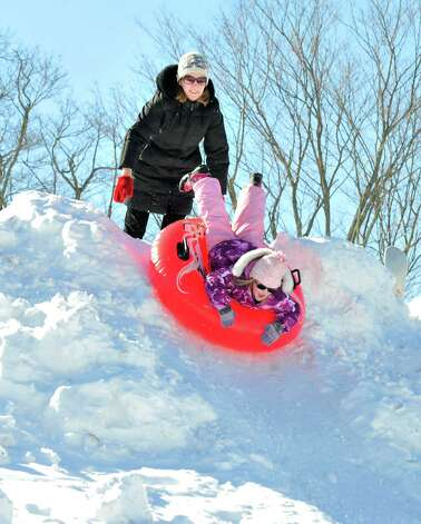 Residents have fun sledding in the snow behind St. Gregory the Great Church in Danbury Saturday, Feb. 9, 2013. Photo: Michael Duffy / The News-Times