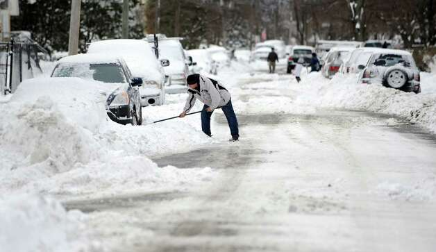 A man digs out his car in Stamford, Conn., on Saturday, February 9, 2013. Photo: Lindsay Perry / Stamford Advocate