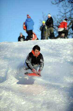 Hunter Bridges catches air on a hill in Cummings Park in Stamford, Conn., on Saturday, February 9, 2013. Photo: Lindsay Perry / Stamford Advocate