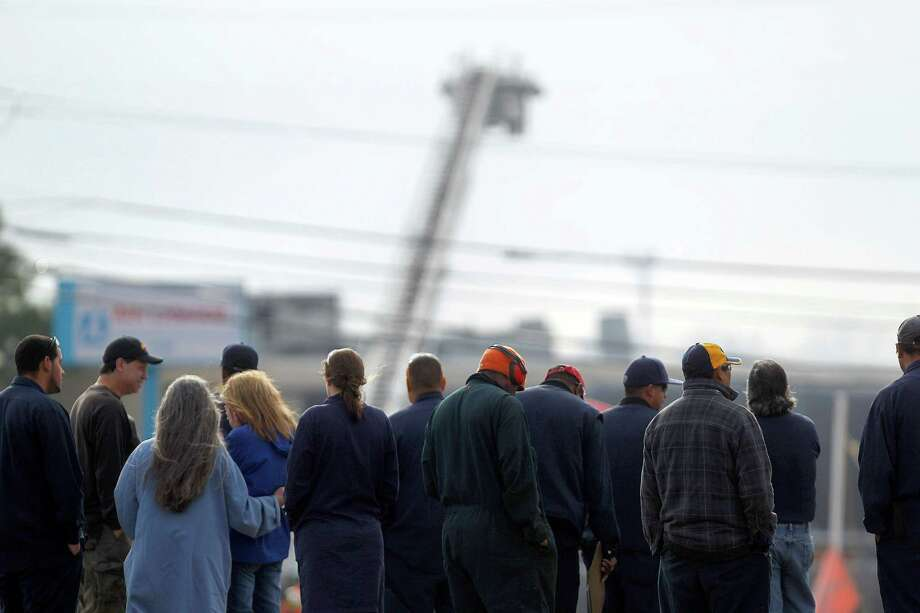 Air Liquide employees watch from a safe distance as firefighters respond to an explosion and fire at the company plant in La Porte. Photo: Johnny Hanson, Staff / © 2013  Houston Chronicle