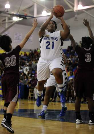 Ozen Lady Panther Nekia Jones, #21, puts it up for two during the Ozen High School girls basketball game against Central High School on Tuesday, January 22, 2013, at Ozen High School.  Ozen won 63 - 53. Photo taken: Randy Edwards/The Enterprise Photo: Randy Edwards