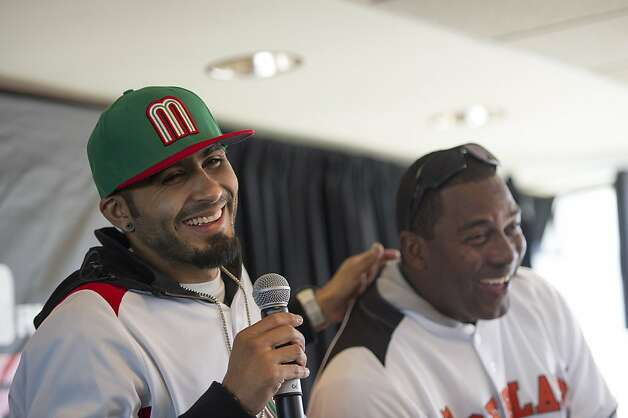 San Francisco Giants pitcher Sergio Romo, left, has a laugh with Giants hitting coach Hensley Meulens during a Q&A session during fan appreciation day at AT&T Park in San Francisco, Calif., on Saturday, Feb. 9, 2013. Photo: David Paul Morris, Special To The Chronicle
