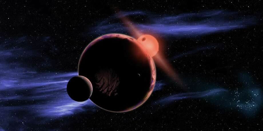 This artist's conception shows a hypothetical planet with two moons orbiting in the habitable zone of a red dwarf star. Photo: David A. Aguilar, HONS / Harvard-Smithsonian Center for A