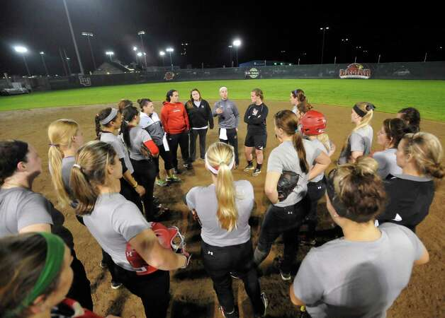 Head coach Holly Bruder,center, back, , and her coaching staff talk to the players after practice. Lamar softball is having it's first season since 1987. Thursday night found the girls team getting practice done at the Ford Park complex. They will open their 2013 season on Saturday.   Dave Ryan/The Enterprise Photo: Dave Ryan