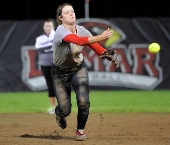 Infielder Shannon Sain throws a caught ball to first base.  Lamar softball is having it's first season since 1987. Thursday night found the girls team getting practice done at the Ford Park complex. They will open their 2013 season on Saturday.   Dave Ryan/The Enterprise Photo: Dave Ryan