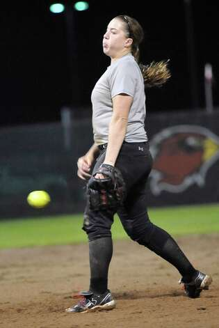 Pitcher Tina Schulz starts throwing from the mound to a batter at the plate.  Lamar softball is having it's first season since 1987. Thursday night found the girls team getting practice done at the Ford Park complex despite their wet field. They will open their 2013 season on Saturday.   Dave Ryan/The Enterprise Photo: Dave Ryan