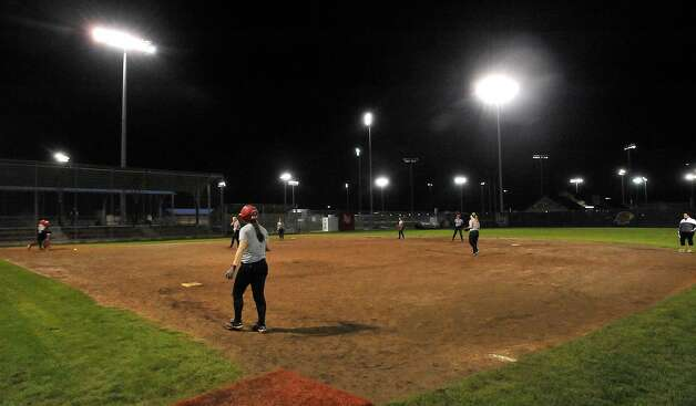 Lamar softball is having it's first season since 1987. Thursday night found the girls team getting practice done at the Ford Park complex despite their wet field due to holes in their tarp covering.  They will open their 2013 season on Saturday.   Dave Ryan/The Enterprise Photo: Dave Ryan