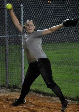 Pitcher Tina Schulz warms up with some practice throws with her catcher before hitting the field with her teammates. Lamar softball is having it's first season since 1987. Thursday night found the girls team getting practice done at the Ford Park complex despite their wet field. They will open their 2013 season on Saturday.   Dave Ryan/The Enterprise