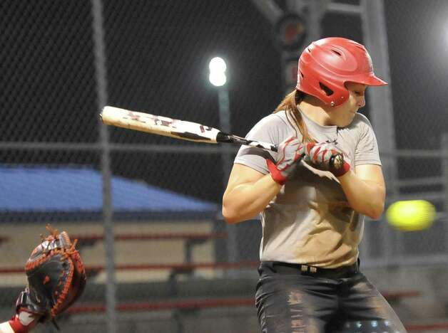 Pitcher Tina Schulz gets her chance at bat during practice. Lamar softball is having it's first season since 1987. Thursday night found the girls team getting practice done at the Ford Park complex despite their wet field. They will open their 2013 season on Saturday.   Dave Ryan/The Enterprise Photo: Dave Ryan