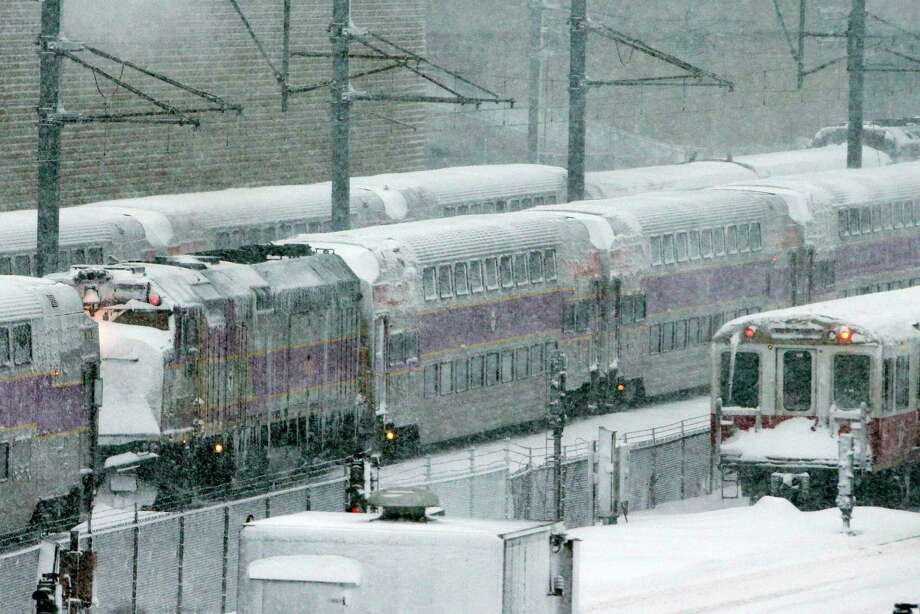 Massachusetts Bay Transportation Authority trains sit idle early Saturday, Feb. 9, 2013 in Boston due to high winds and the nearly two-feet of snow that fell in the area overnight. (AP Photo/Gene J. Puskar) Photo: Gene J. Puskar