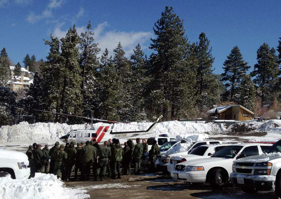 Law enforcement officials gather to discuss plans to resume the search for fugitive Christopher Dorner, Saturday Feb. 9, 2013 near Big Bear, Calif. More than 100 law enforcement officers, some in armored personnel carriers, hunted Saturday for the former Los Angeles police officer suspected of going on a deadly rampage this week to get back at those he blamed for ending his police career. (AP Photo/Tami Abdollah) Photo: Tami Abdollah