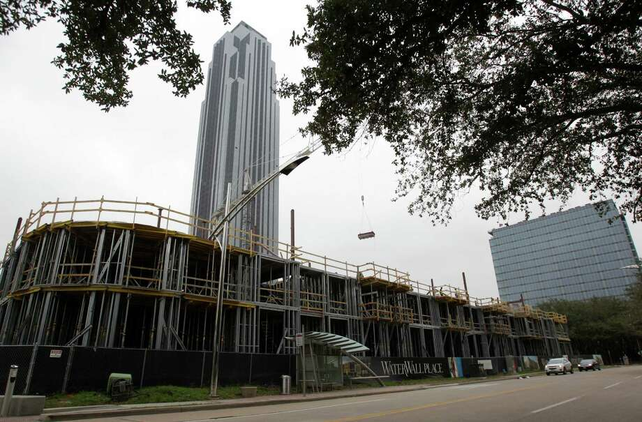 WaterWall Place, a high-end apartment complex, shown next to Williams Tower, is under construction, one of the many projects bringing jobs to Houston. The seven-story property will overlook Gerald D. Hines Waterwall Park. Photo: Melissa Phillip, Staff / © 2013 Houston Chronicle