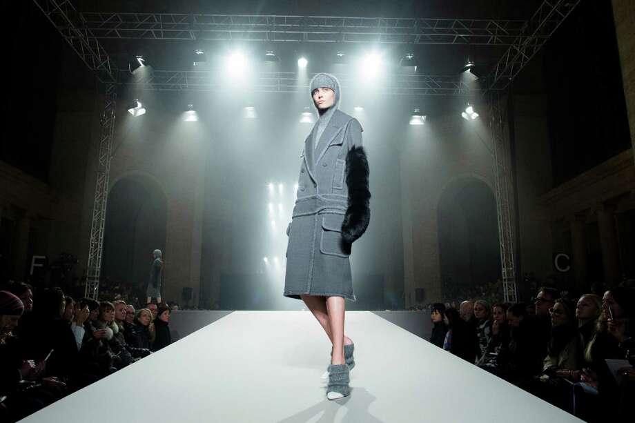 A model walks the runway during the Alexander Wang fall 2013 fashion show. Photo: John Minchillo