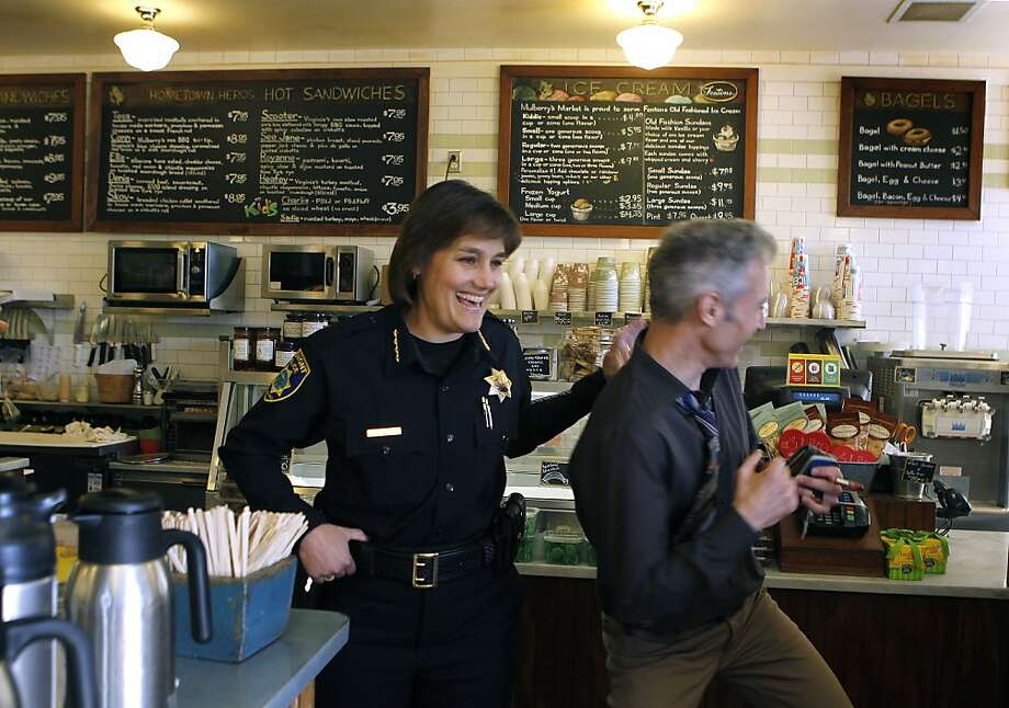 New Piedmont Police Chief Rikki Goede jokes with Joe Piazza while ordering coffee at Mulberry's Market. Goede previously served in law enforcement in San Jose for 16 years and San Diego for 10 years. Photo: Paul Chinn, The Chronicle