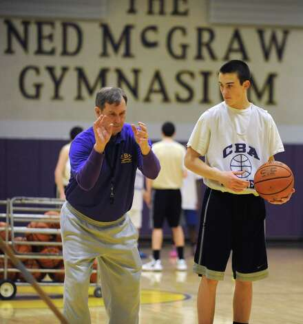 CBA basketball coach Dave Doemel works with    Jake Foglia on his free throw form during a drill at practice on Wednesday Feb. 6, 2013 in Albany, N.Y.  (Lori Van Buren / Times Union) Photo: Lori Van Buren