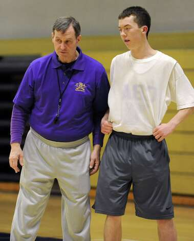 CBA basketball coach Dave Doemel works with Matt Hamel during a drill at practice on Wednesday Feb. 6, 2013 in Albany, N.Y.  (Lori Van Buren / Times Union) Photo: Lori Van Buren
