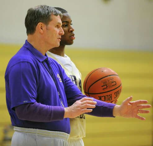 CBA basketball coach Dave Doemel works with senior player Tyrell Ramsey during a drill at practice on Wednesday Feb. 6, 2013 in Albany, N.Y.  (Lori Van Buren / Times Union) Photo: Lori Van Buren