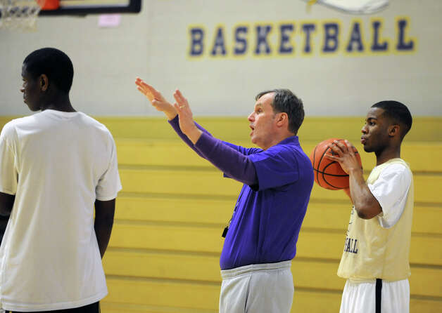 CBA basketball coach Dave Doemel talks to his players during a drill at practice on Wednesday Feb. 6, 2013 in Albany, N.Y.  (Lori Van Buren / Times Union) Photo: Lori Van Buren