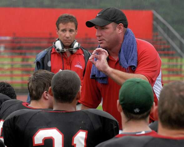 (Hans Pennink Special to The Times Union) New  Head Coach Tony Fruscio of Albany Academy talks to his team after winning his first game 20-16 against Schalmont High School during their Football game at Albany Academy in Albany, N.Y., Saturday, September 6, 2008 Photo: Hans Pennink Hans Pennink / 00000153A
