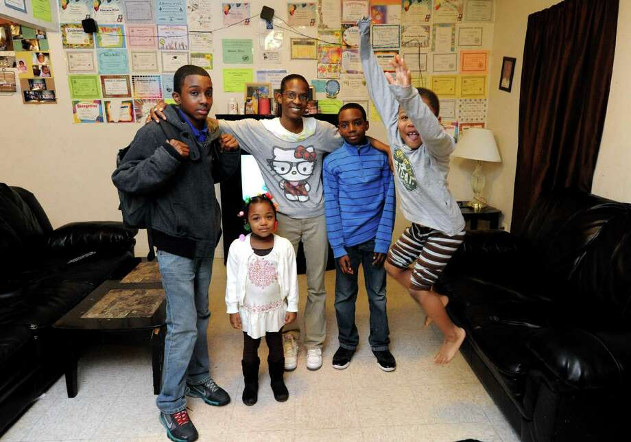 Sophia Joseph, center, with four of her five children Khaseem Allah,13, left, Ky-Semani McCall, 3, Khasier Allah, 10, and Ky-Semaj Joseph, 5, at their home on Wednesday Jan. 30,2013 in Albany, N.Y. (Michael P. Farrell/Times Union) Photo: Michael P. Farrell