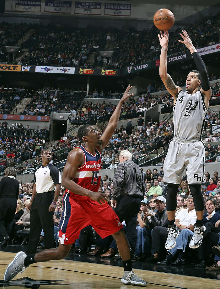 Spurs guard Danny Green, shooting over the Wizards' Jordan Crawford, grew up in the boroughs of New York and will have family on hand tonight. Photo: Edward A. Ornelas / San Antonio Express-News