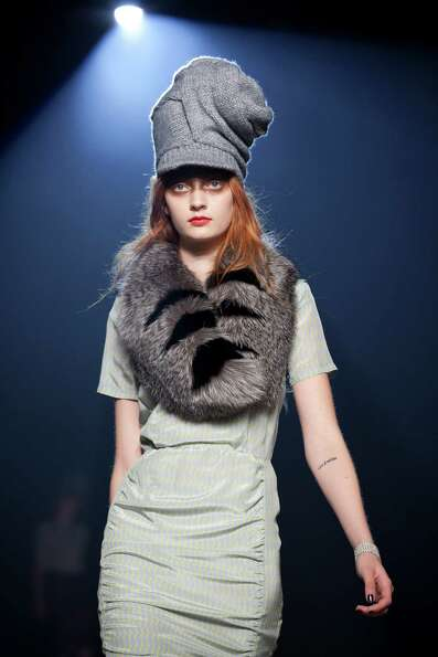 A model walks the runway during the Band of Outsiders fall 2013 fashion show.