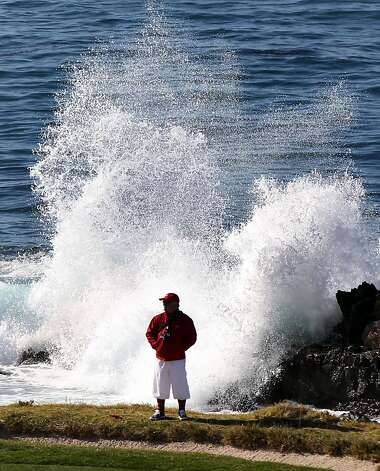 A golf marshal waits on the 7th green for the next foursome to arrive during the third round of the AT&T Pebble Beach National Pro-Am at Pebble Beach Golf Links on February 9, 2013 in Pebble Beach, Calif. Photo: Lance Iversen, The Chronicle