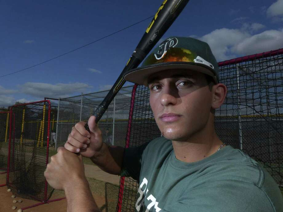To be closer to home, TCU-bound infielder Eric Garza will play his senior season at Reagan after being at MacArthur. Photo: Billy Calzada / San Antonio Express-News