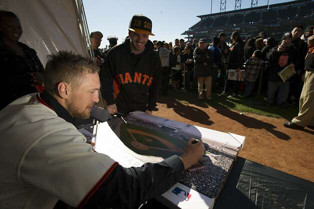 San Francisco Giants right fielder Hunter Pence signs a photograph for Sammy Swann of Stockton during fan appreciation day at AT&T Park in San Francisco, Calif., on Saturday, Feb. 9, 2013. Photo: David Paul Morris, Special To The Chronicle
