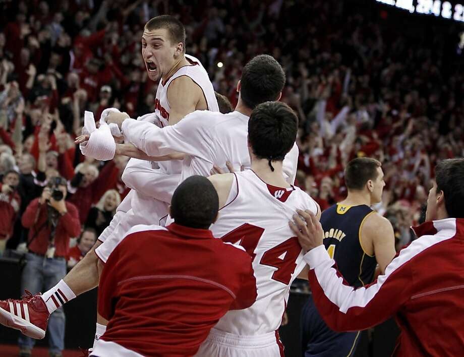 Wisconsin's Ben Brust celebrates after hitting a game-tying three-pointer at the end of regulation. Photo: Andy Manis, Associated Press