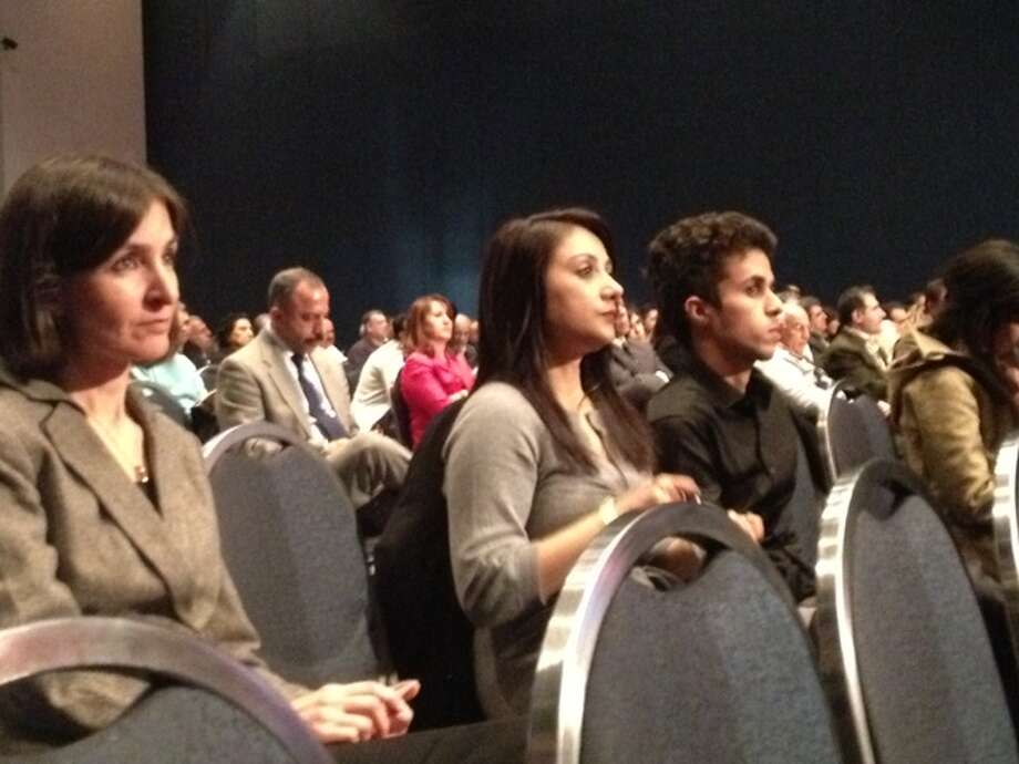 Friends and Dallas residents Homeika Hesami (left) and  Mahim Shaikh (right) listen to the speakers at the convention.