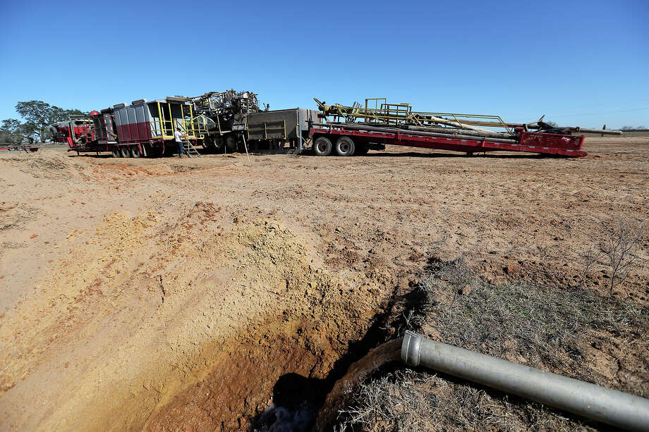 Water is pumped through irrigation pipes to a drilling site in Frio County, Thursday, Jan. 17, 2013. Funded by San Antonio third-generation wildcatter Harvey Howell, the plans were to drill to 4,000 feet in search of oil Photo: Jerry Lara, San Antonio Express-News / © 2013 San Antonio Express-News