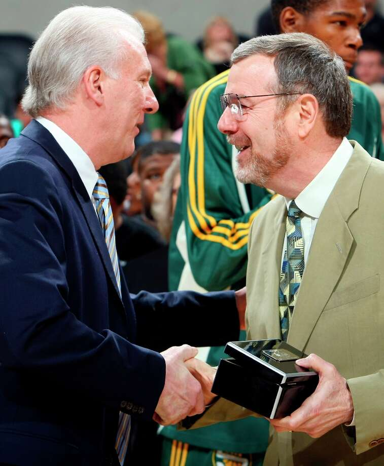 Spurs coach Gregg Popovich (left) shakes hands with SuperSonics' coach P.J. Carlesimo after Carlesimo was giving his championship ring prior to the start of the game April 11, 2008 at the AT&T Center Photo: EDWARD A. ORNELAS, SAN ANTONIO EXPRESS-NEWS / SAN ANTONIO EXPRESS-NEWS