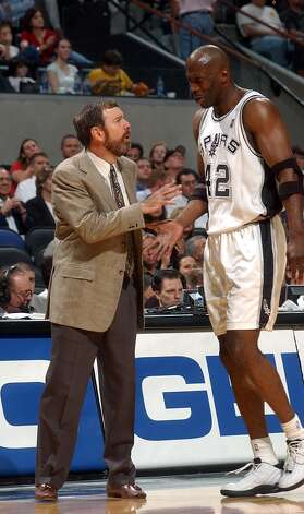 San Antonio assistant coach P.J. Carlesimo stood in for head coach Gregg Popovich, who was suspended for the Spurs' game against Miami in the SBC Center on Nov. 4, 2003. Carlesimo encourages Kevin Willis during first-half action. Photo: BILLY CALZADA, SAN ANTONIO EXPRESS-NEWS / SAN ANTONIO EXPRESS-NEWS