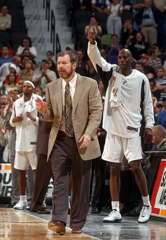 Spurs assistant coach P.J. Carlesimo, who piloted the team to victory over the Miami Heat on Tuesday night, watches the action on the court. Nov. 4, 2003. Head coach Gregg Popovich was under suspension. Photo: BILLY CALZADA, SAN ANTONIO EXPRESS-NEWS / SAN ANTONIO EXPRESS-NEWS