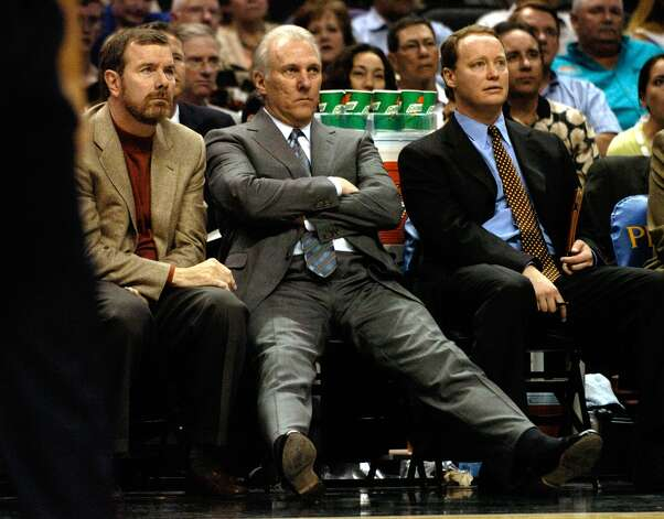Spurs coach Greg Popovich (center) sits back with assistants P.J. Carlesimo (left) and Mike Budenholser at the SBC Center during Game 2 of the Western Conference semifinals, May 5, 2004. Photo: BAHRAM MARK SOBHANI, SAN ANTONIO EXPRESS-NEWS / SAN ANTONIO EXPRESS-NEWS