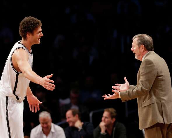 Nets center Brook Lopez (left) argues with Nets interim head coach P.J. Carlesimo at the Barclays Center, Wednesday, Jan. 30, 2013 in New York. Photo: Kathy Willens, Associated Press / AP