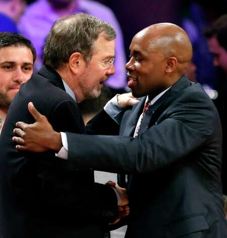 Nets interim coach P.J. Carlesimo and Magic coach Jacque Vaughn greet each other at the conclusion of their game at the Barclays Center, Monday, Jan. 28, 2013 in New York. The Nets defeated the Magic 97-77. Photo: Kathy Willens, Associated Press / AP