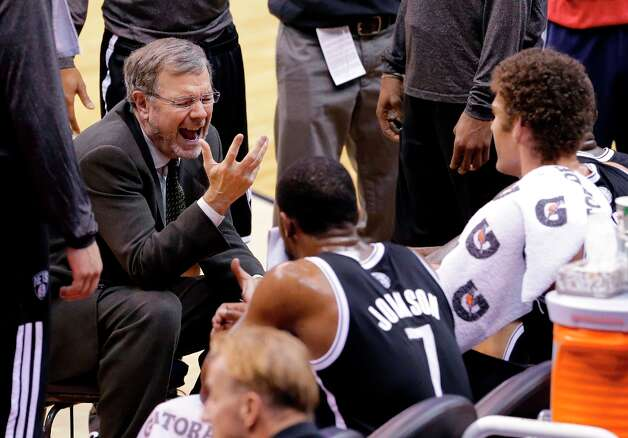 Nets interim coach P.J. Carlesimo (left) talks with his team during a timeout in the second half against the Wizards on Friday, Feb. 8, 2013 in Washington. The Wizards won 89-74. Photo: Alex Brandon, Associated Press / AP