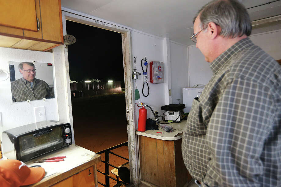 Harvey Howell, president of H.H. Howell, Inc., an oil and gas exploration company in San Antonio, keeps an eye on the drilling rig at a site in Frio County, Sunday, Jan. 20, 2013. Howell, a third generation wildcatter, was funding the operation. He was waiting for the the drilling to hit the San Miguel Sandstone formation an area of great interest. At the end of the night, no indications of petrochemicals were found in the formation. Photo: Jerry Lara, San Antonio Express-News / © 2013 San Antonio Express-News